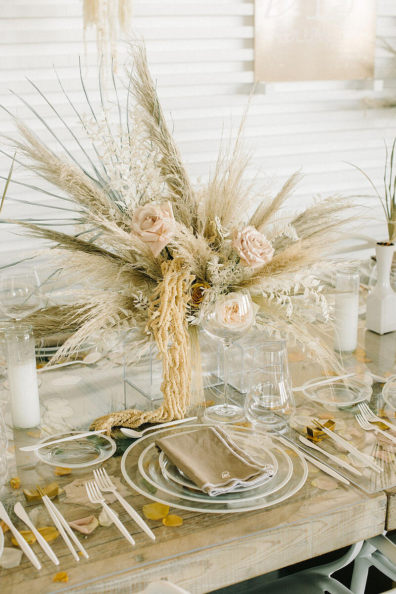 Centerpiece featuring Mayesh Wholesale products including roses, pampas grass, dried bleach preserved ruscus and fern.