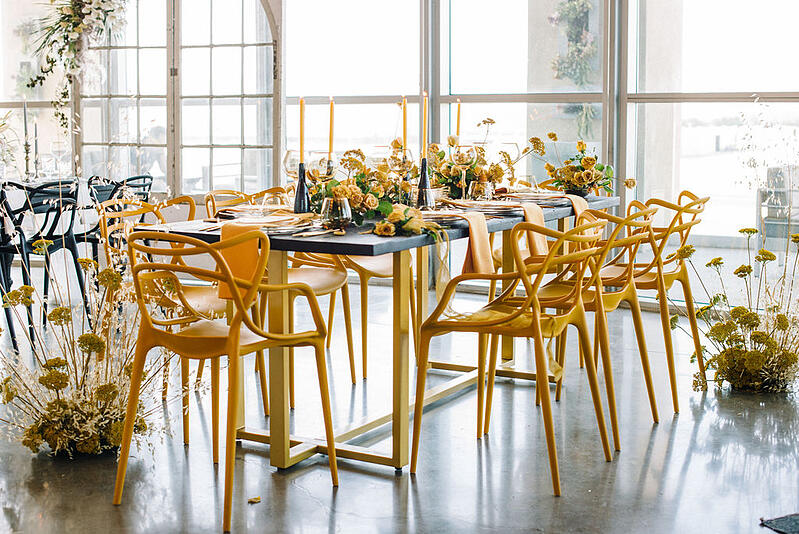 Installation and tablescape featuring Mayesh Wholesale products including yellow yarrow.