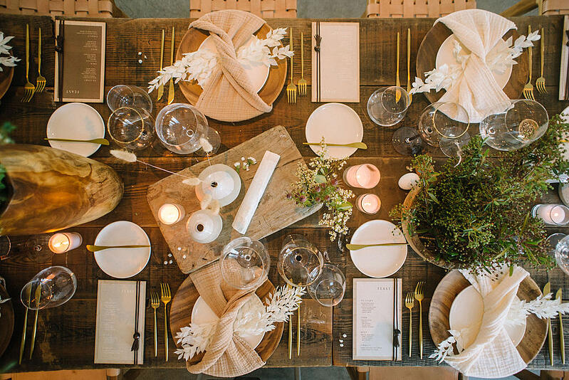 Tablescape featuring bleached preserved ruscus.