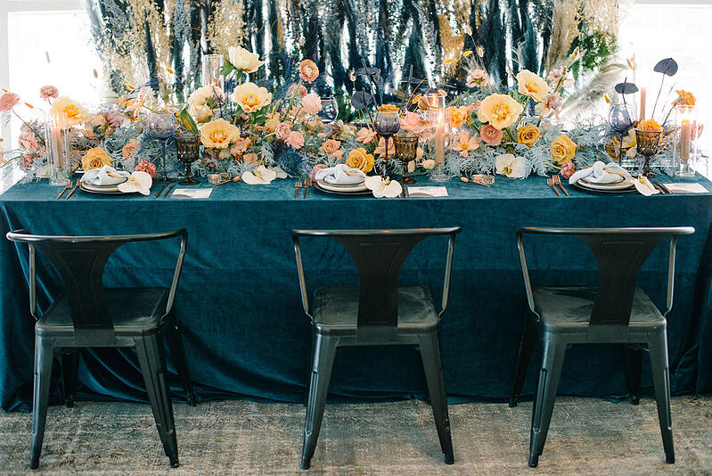 Tablescape with tulips, peonies, ranunculus, anthuriums, roses, bunny tails from Mayesh Wholesale.