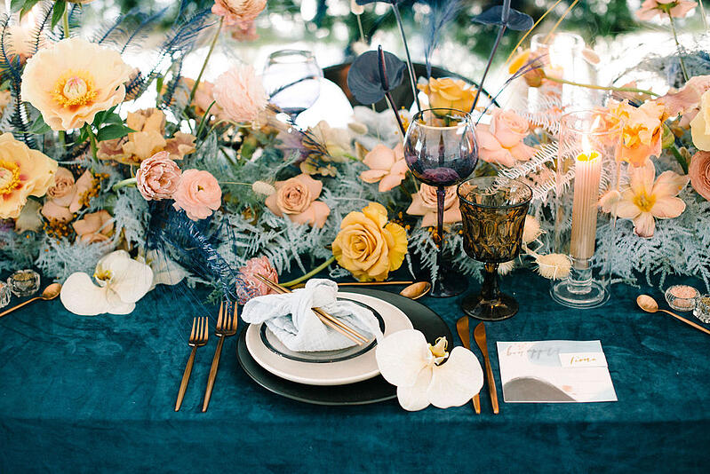 Tablescape with tulips, peonies, ranunculus, anthuriums, roses, bunny tails, orchids from Mayesh Wholesale.