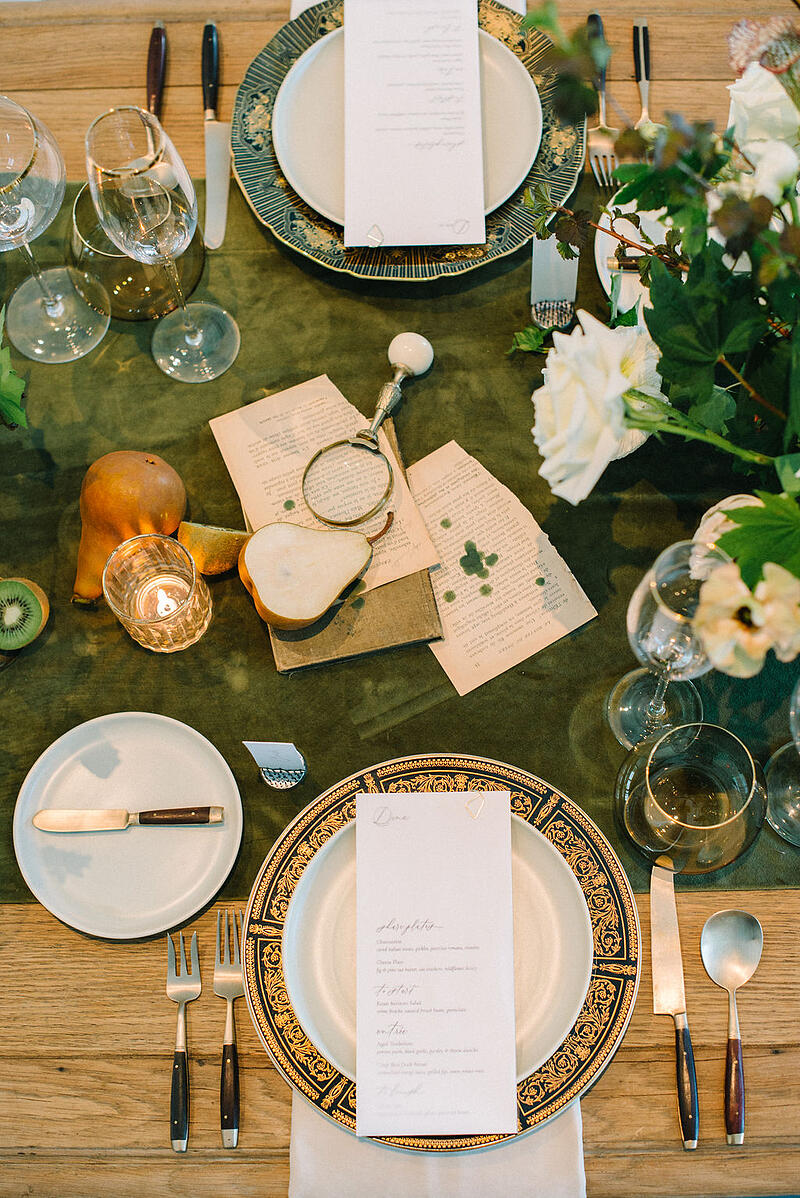 Table setting and tablescape featuring pears, kiwi and Mayesh Wholesale flowers.