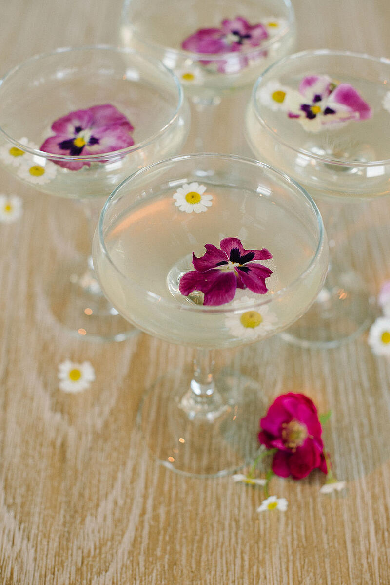 Cocktail with edible flowers at borrowed BLU event.