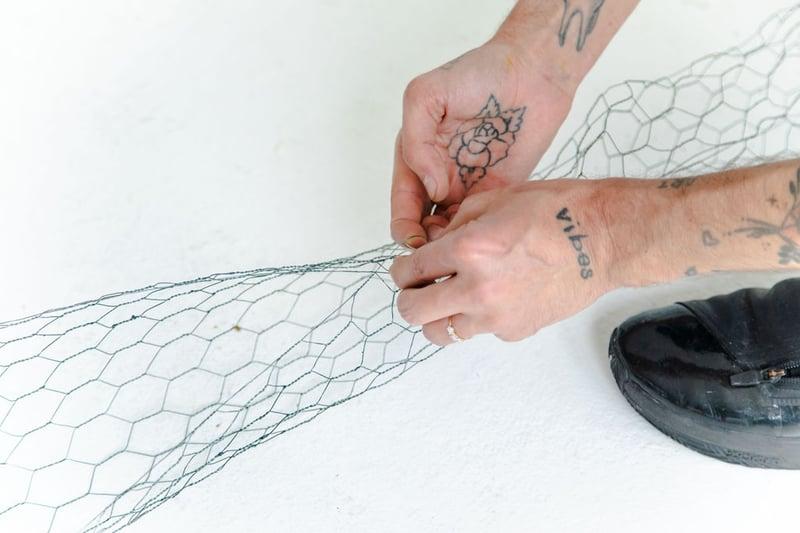 floral design mechanics: chicken wire sausage