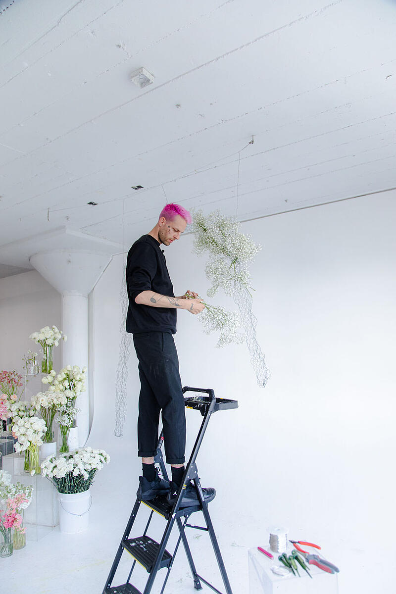 hanging floral arch installation