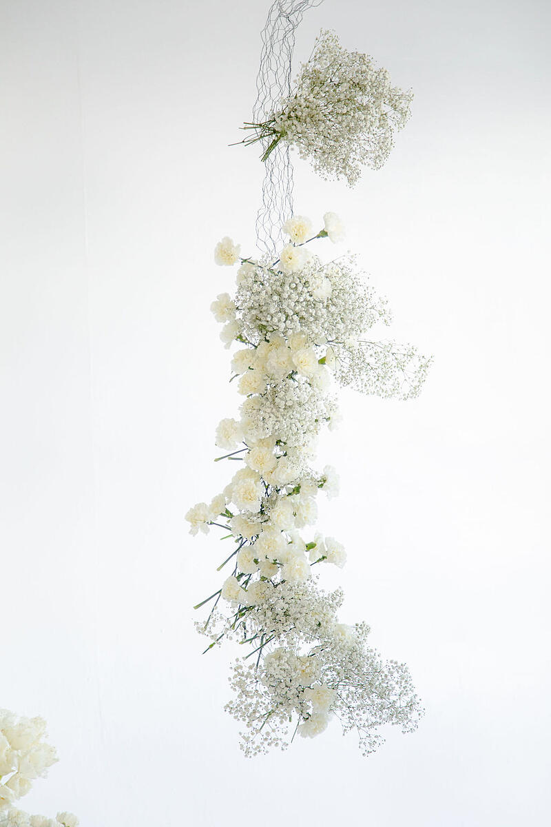 hanging floral arch installation with baby's breath and carnations