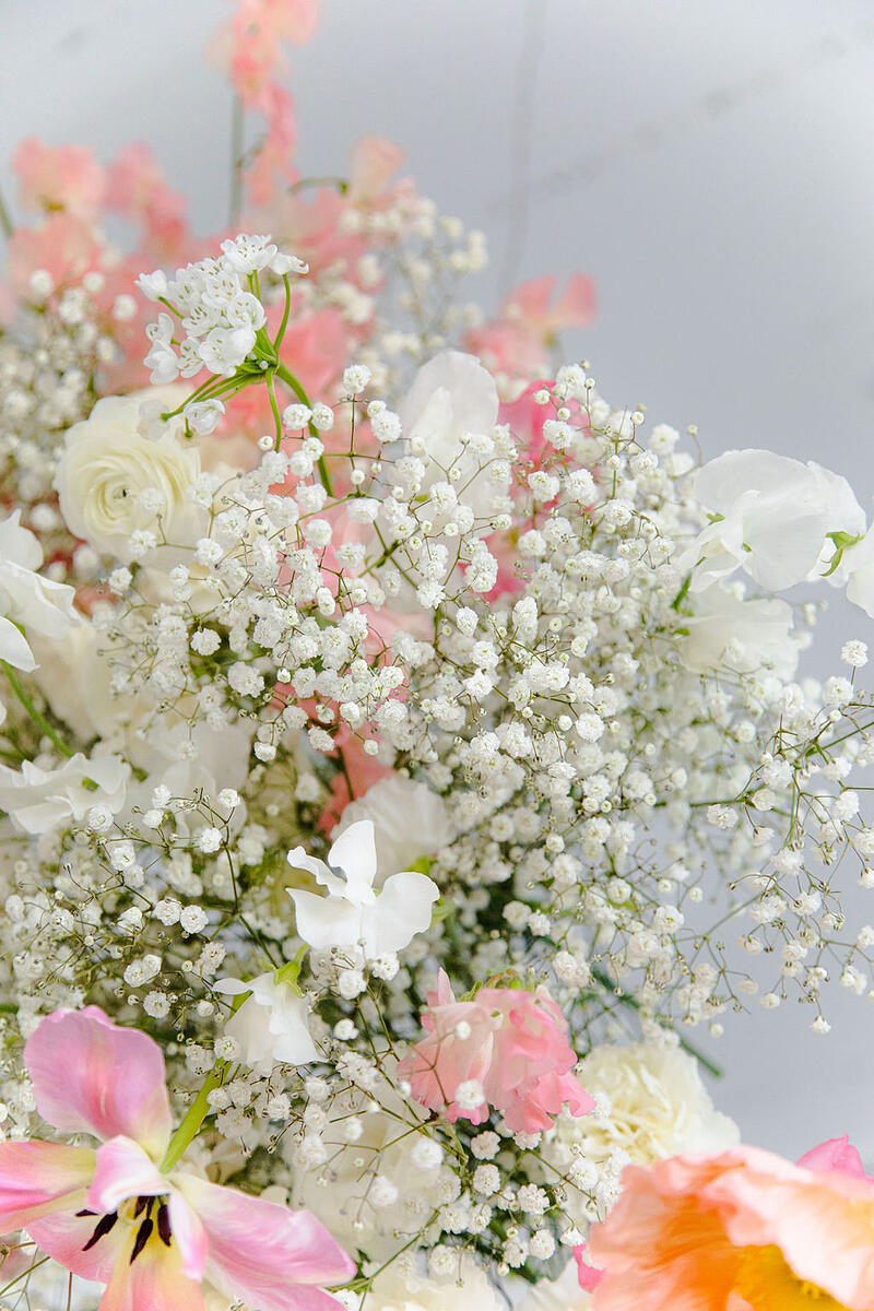 blush, pink, and white hanging floral arch installation