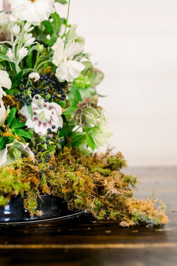 centerpiece with double helleborus, viburnum berries, Japanese anemones, butterfly ranunculus