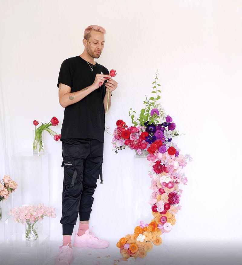 porch wedding installation - flowers cascading down a column - dahlias, ranunculus, sweet peas