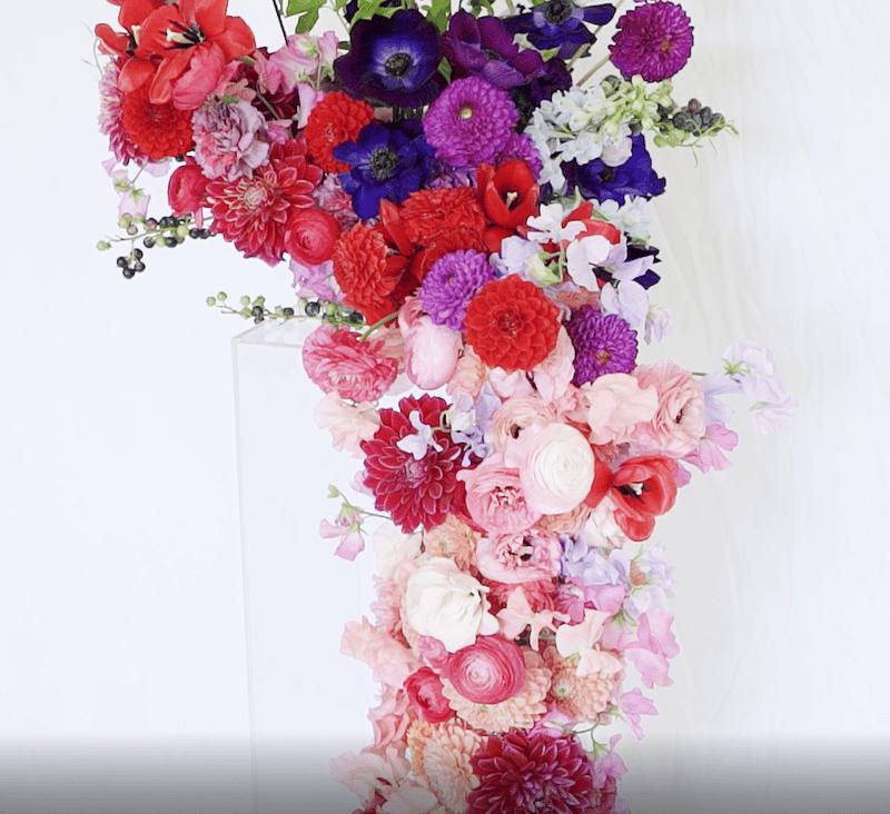 porch wedding installation - flowers cascading down a column - dahlias, ranunculus, sweet peas, anemones