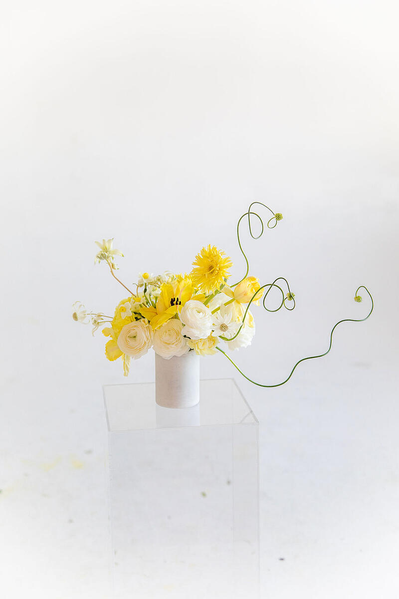 cream, white, and yellow flower arrangement by Anthony Maslo