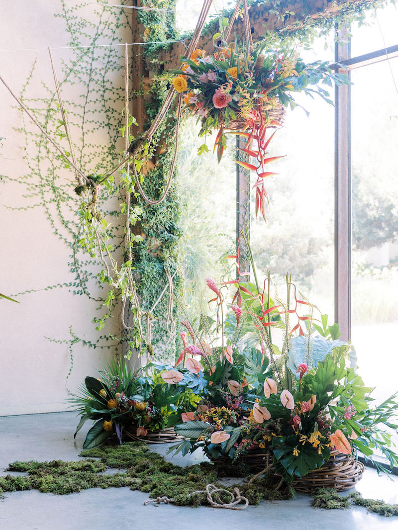 Mayesh Design Star workshop installation featuring heliconia, sheet moss, yellow roses, pink ginger, cymbidiums, song of india, pink anthurium, yellow pincushion