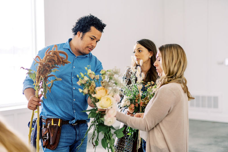 Shean Strong helping students design bouquets at the Mayesh Design Star workshop in Columbus, OH