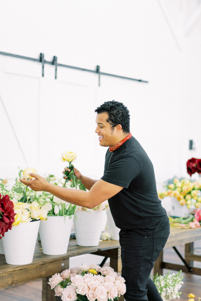 Shean Strong designing a bouquet with garden roses