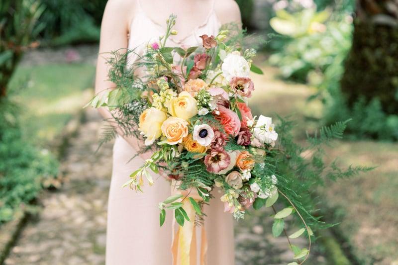 Bouquet with anemones, lisianthus, ranunculus, plumosus, stock, garden roses.